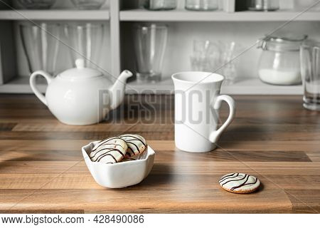 White Tea Cup, Teapot And Cookies In White Bowl On The Countertop Of A Scandinavian-style Kitchen, T