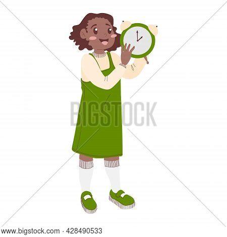 An African American Schoolgirl In A Green Sundress Holds An Alarm Clock In Her Hands. Concept Welcom