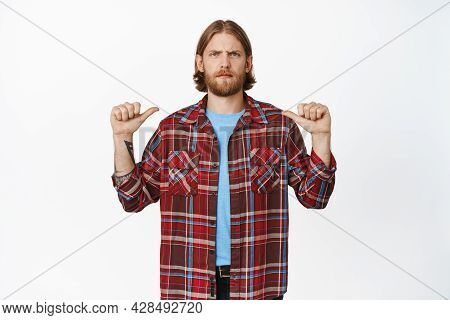 Angry Blond Guy Pointng At Himself, White Background