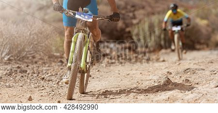 Mountain Bikers Riding On Bike Singletrack Trail, Front View Of Mountain Biker. Mountain Bike Race