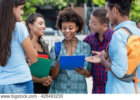 Beautiful African American Female Student With Group Of International Students