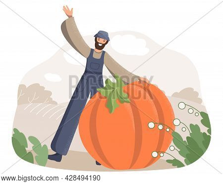 A Happy Male Farmer In Work Clothes Shows Everyone A Giant Pumpkin Against The Background Of A Field