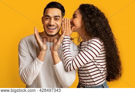 Gossips Concept. Lady Sharing Secret With Her Excited Arab Boyfriend