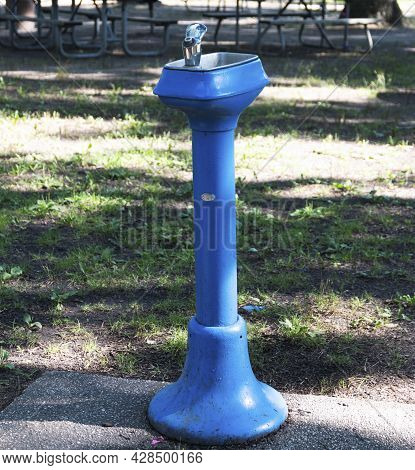 Vertical View Of An Old Blue Public Water Fountain In Belmont Lake State Park.