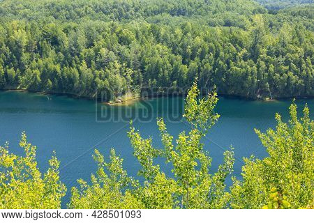 A Former Mine Pit Now A Recreational Lake In The Woods.