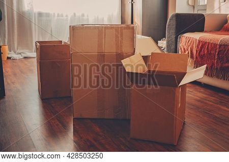 Moving Day, Move Into New Home, Moving Home Checklist. Carton Boxes With Clothes And Other Things Pr