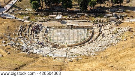 Ancient Greek Theatre Of Dionysus At Acropolis Foot, Athens, Greece. It Is Famous Tourist Attraction