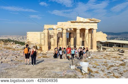 Athens - May 8, 2018: People Visit Famous Acropolis Of Athens, Greece. View Of Ancient Greek Propyla