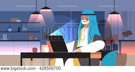 Senior Arab Businessman Freelancer Working On Laptop Arabic Man Sitting At Workplace In Dark Night H