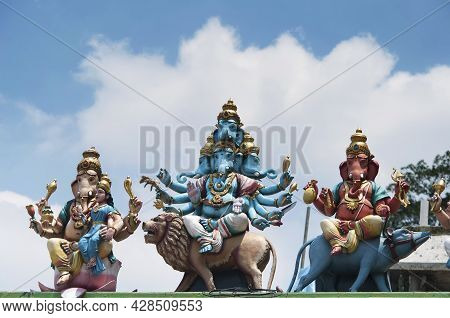 Various Depictions Of Lord Ganesha, Hindu Elephant Deity Atop A Temple At The Batu Caves Scenic Area