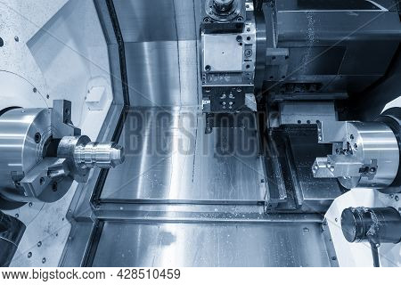 The  Double-turret Cnc Lathe Machine  Cutting The Metal Shaft Parts. The Hi-technology Metal Working