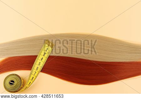 Curls Of Brown-haired Women, Blondes And A Measuring Tape On A Delicate Background.the Concept Of Bu