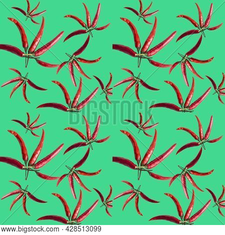 Seamless Background With Red Peppers. Hot Chili Peppers Isolated On Green. Chili Peppers Close Up. P