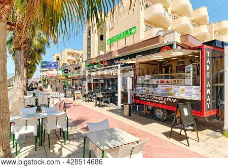Orihuela, Spain - May 14, 2021: Commercial Street With Outdoor Restaurants And Cafes In The Street P
