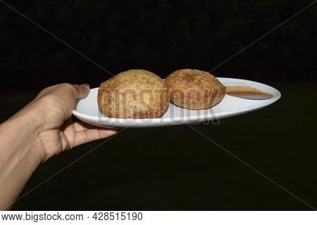 Female Holding Serving Plate Of Delicious Popular Indian Teatime Snack Or Breakfast Dish Item Onion