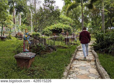 A Long View Of Natural Arch Rock Garden Visiting Tourist In Tirumala, Tirupati: Tirumala, Andhra Pra