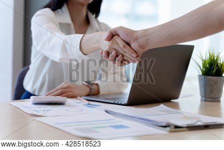 Businesswoman Or Bank Officer Shaking Hands After Agreeing To Work Together Successfully In Office.