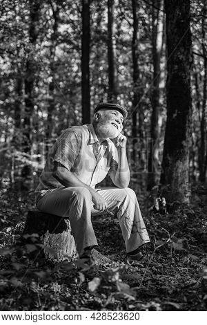 Back Into The Wild. Senior Man Relax In Wild Nature. Aged Pensioner Enjoy Autumn Landscape. Wild Fau