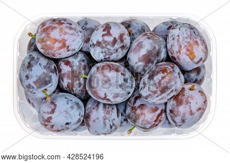 Ripe Prune Plums In A Clear Plastic Container. Fresh Fruit And A Subspecies Of Prunus Domestica, A F