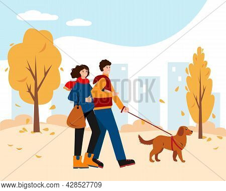 Happy Woman And Man In Bright Warm Clothes Walking In Autumn Park With Dog. Healthy Lifestyle And Re
