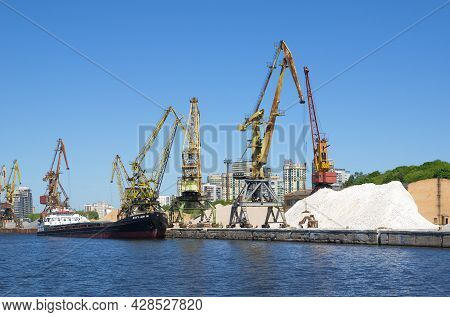 Moscow, Russia - June 3, 2021: The Embankment Of The Khimki Reservoir. Port Cranes And A Barge At Th