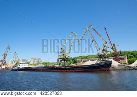 The Moscow Canal. Port Cranes And A Barge At The Northern River Station In Moscow, Russia
