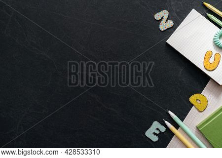 Study, Education, Learning At School Concept On Black Background With Copy Space. Working Table For