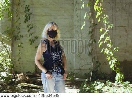 Young Girl Photographer. Blonde With A Camera. Girl Wearing A Mask From Coronavirus. Woman Tourist,