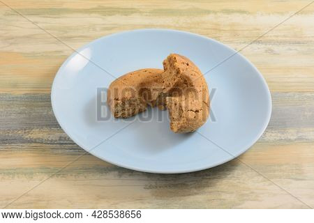 Broken Greek Grape Must Moustokouloura Soft Cookie Halves On Blue Snack Plate