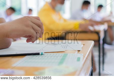 Blurred Hand Female Asian Students Taking Exam Tes Concentration Reading Document Exercise At Classr