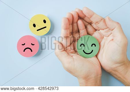 Smiling Face In Hand On Blue Background  Satisfaction Survey ,good Feedback Rating And Positive Cust