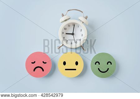 White Analog Clock And Emotion Face On Blue Background, Satisfaction Survey ,good Feedback Rating An