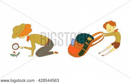 Cute Boy And Girl Junior Scout Pulling Heavy Backpack And Watching Flower Through Magnifying Glass V