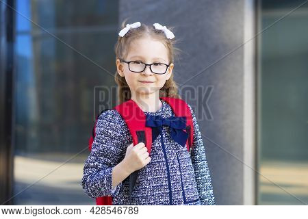 Cute Funny Smart Schoolgirl With Schoolbag. Back To School. Happy Beautiful Child, Clever Girl With