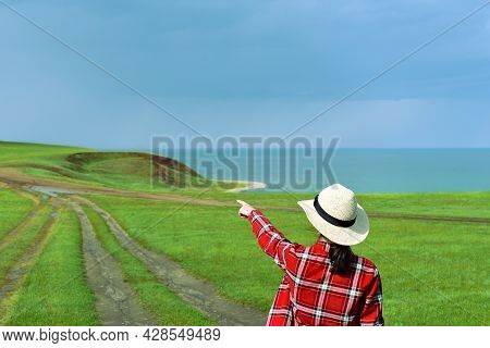 Young Girl In Red Shirt Pointing Her Finger To The Path Of Cape Kharantsy
