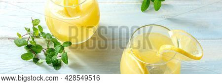 Lemonade Panorama On A Wooden Background. Homemade Fresh Drink With Lemon And Mint. Healthy Organic