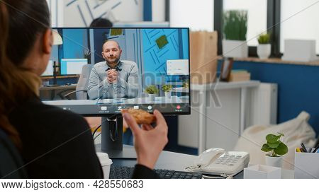 Businesswoman Discussing With Remote Entrepreneur During Online Videocall Meeting Conference Having