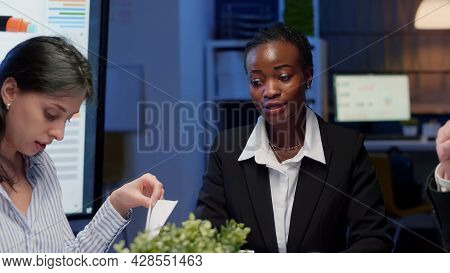 African American Businesswoman Brainstorming Business Strategy Working In Meeting Room Late At Night