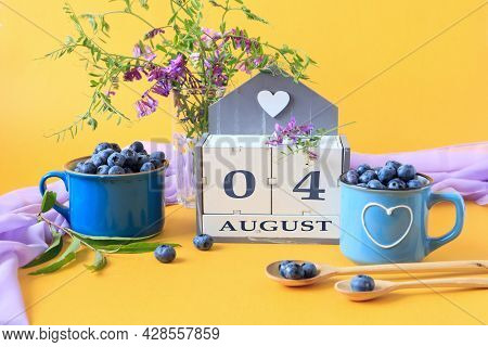 Calendar For August 4 :the Name Of The Month Of August In English, Cubes With The Numbers 0 And 4, B