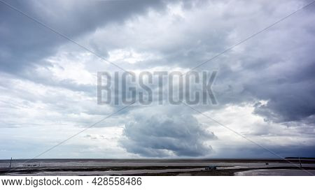 Cloudy Storm In The Sea Before Rainy. Tornado Storms Cloud Above The Sea. Monsoon Season. Huge Storm