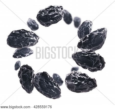 Dried Prunes Levitate On A White Background
