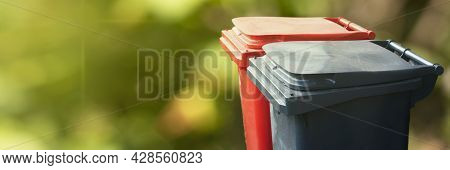 Two Trash Bin On Green Nature Background. Separate And Sorting Garbage. Recycling And Storage Of Was