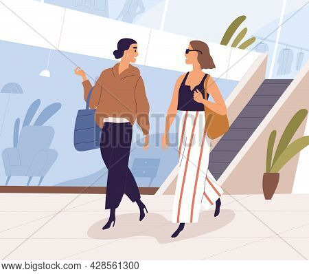 Woman Walking In Shopping Mall. Happy Female Friends Talking While Strolling With Bags In Modern Sho