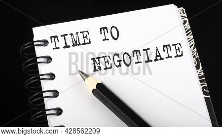 Time To Negotiate Written Text In Small Notebook On Black Background