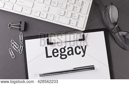 Office Paper Sheet With Text Legacy And Keyboard. Business