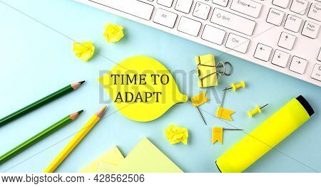 Text Sign Showing Time To Adapt With Office Tools And Keyboard On The Blue Background