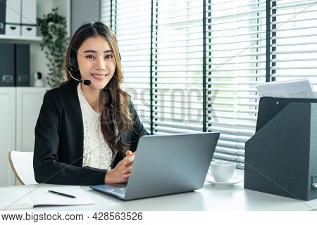 Portrait Of Beautiful Asian Business Woman Call Center Work In Office. Attractive Beautiful Professi