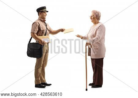 Young postman in a uniform delivering a letter to an elderly lady isolated on white background