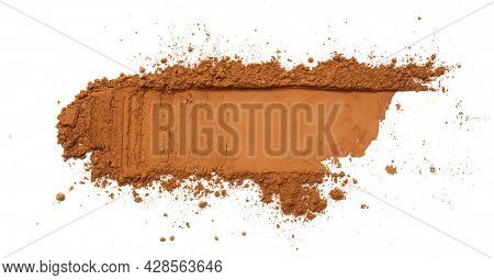 Cocoa powder stroke isolated on white background, top view