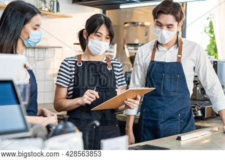 Asian Cafe Manager Leader Explain Job Working To Barista And Waitress. Beautiful Coffeehouse Worker